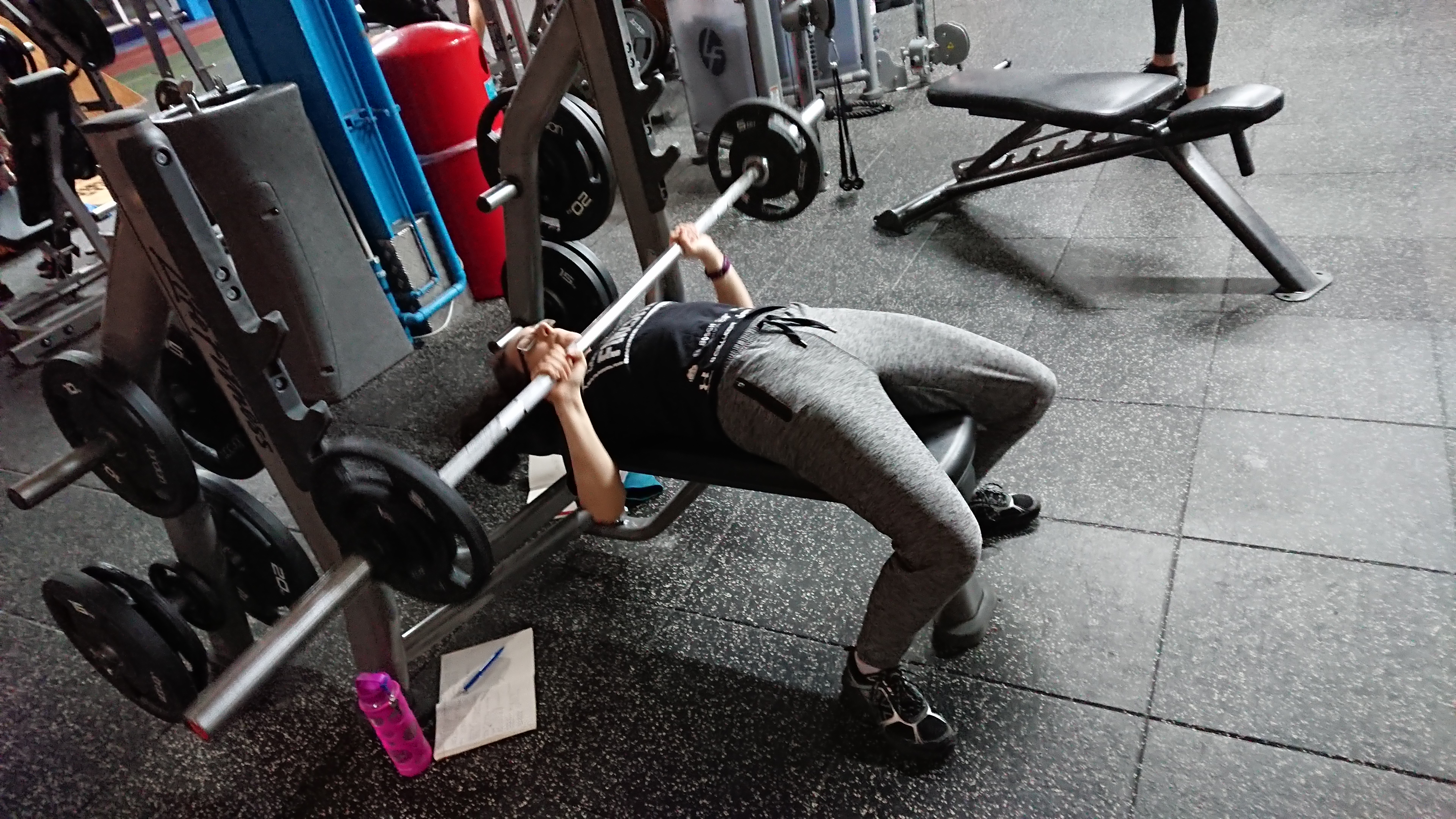 Me, partway through bench pressing 32.5 kg.