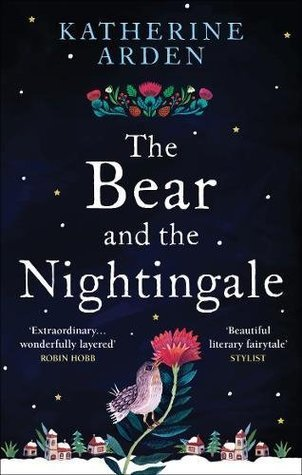 Cover for The Bear and the Nightingale, an illustrated nightingale perches on the stem of a red flower in front of a snowy villagescape at the bottom of the image. Most of the cover is a dark night with stars scattered across it, and the title is in large font taking up a good third of the cover.