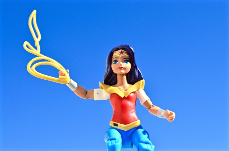 Plastic Wonder Woman toy, holding her lasso up and gazing off into the distance.