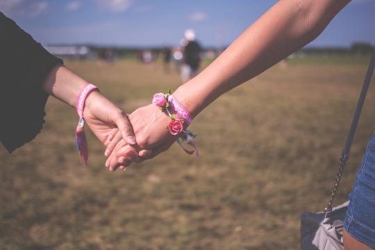 Close up of held hands, both women's hands.