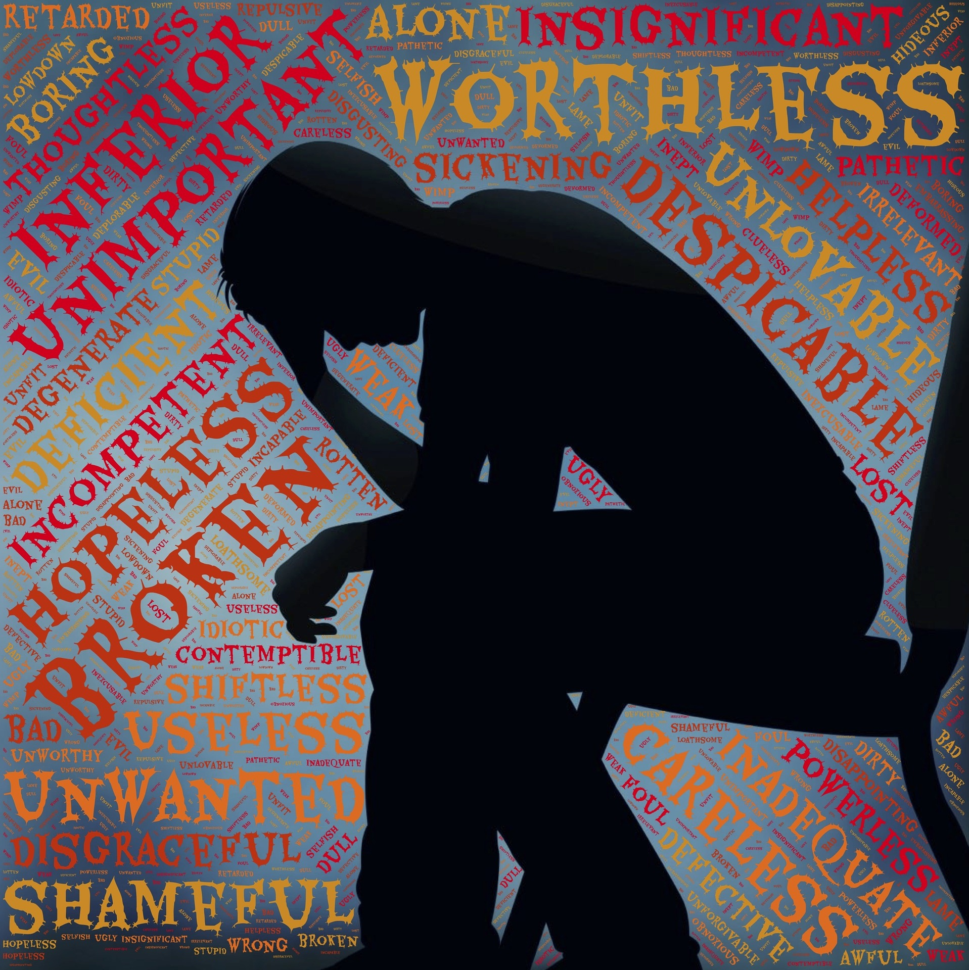 """A figure sits hunched over in a chair, with negative words filling the space around them (""""insignificant"""" """"worthless"""" """"incompetent"""" """"unlovable"""" etc)."""