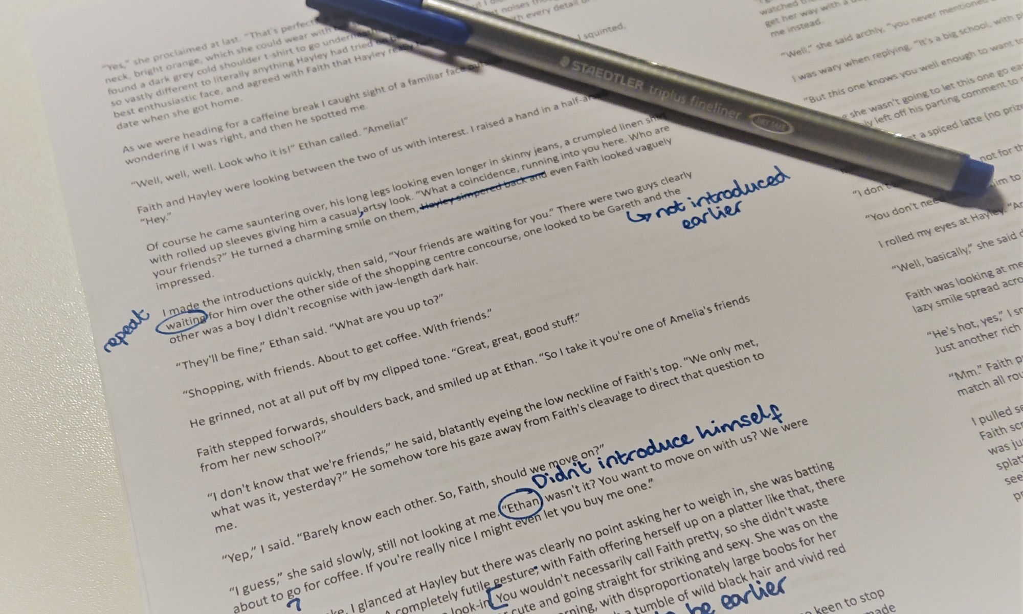 A printed sheet of a story in progress with handwritten notes in blue ink