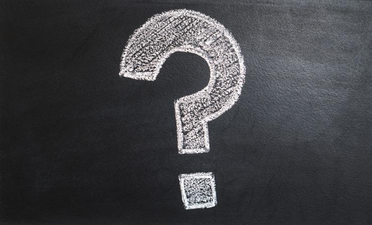 A white question mark drawn onto a blackboard.