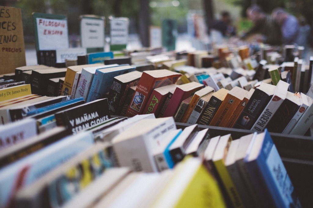 Picture of a stall crowded with books.